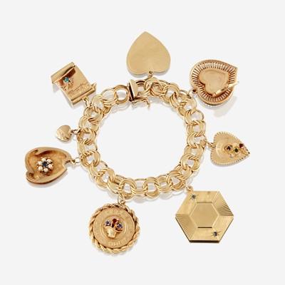 Lot 25 - A fourteen karat gold charm bracelet