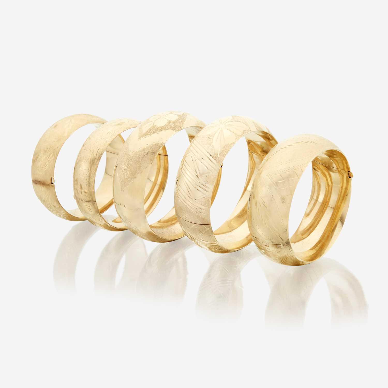 Lot 44 - A collection of five fourteen karat gold bangles