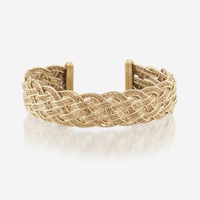 Lot 132 - A fourteen karat gold cuff bracelet