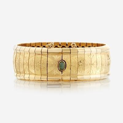 Lot 21 - An eighteen karat gold bracelet with gem-set clasp