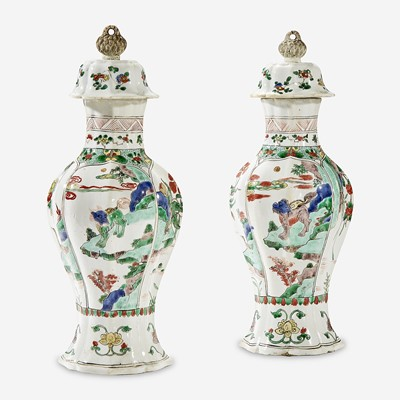 Lot 49 - A pair of Chinese famille verte-decorated porcelain baluster vases and covers