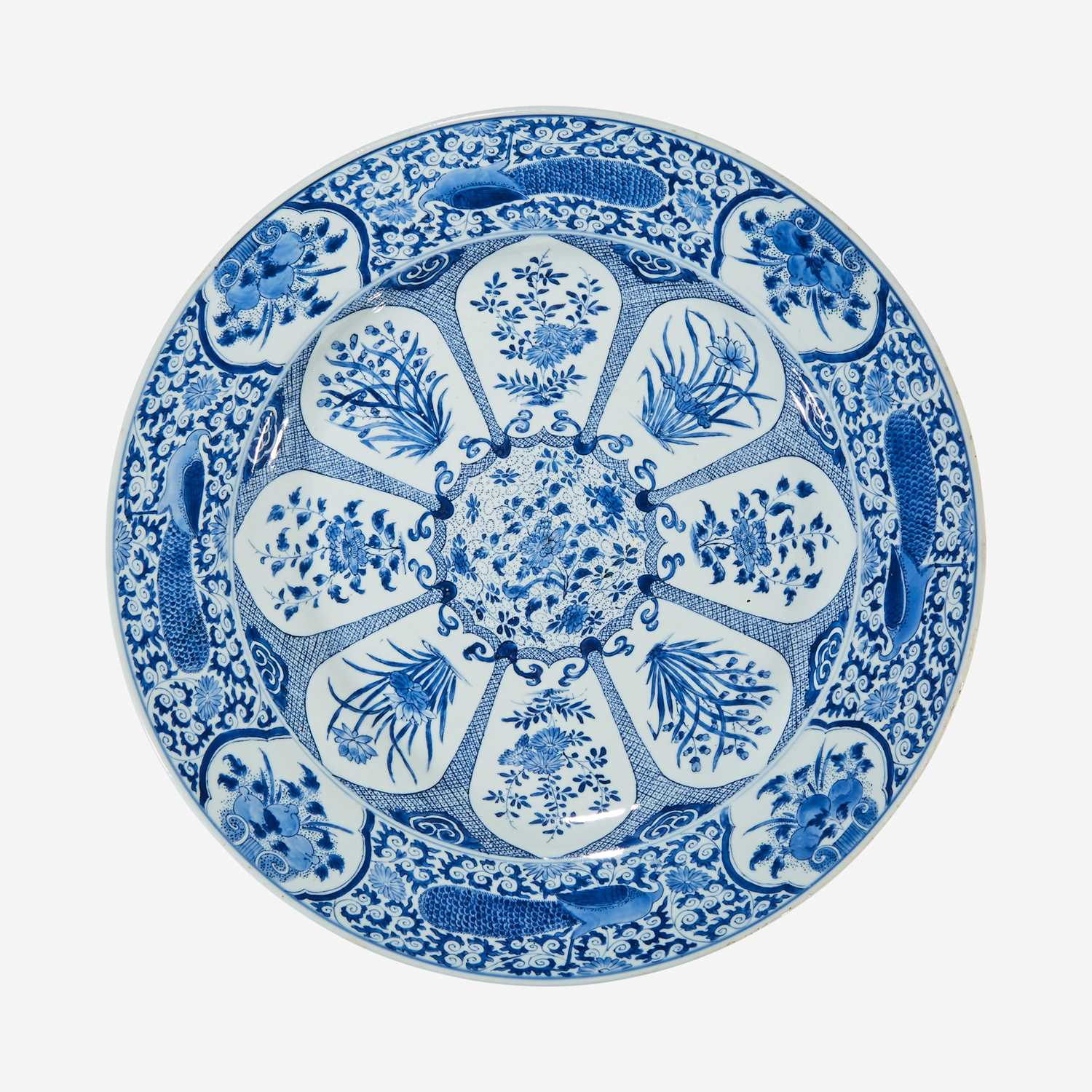 "Lot 35 - A large Chinese blue and white ""Peacock and Rosette"" charger"