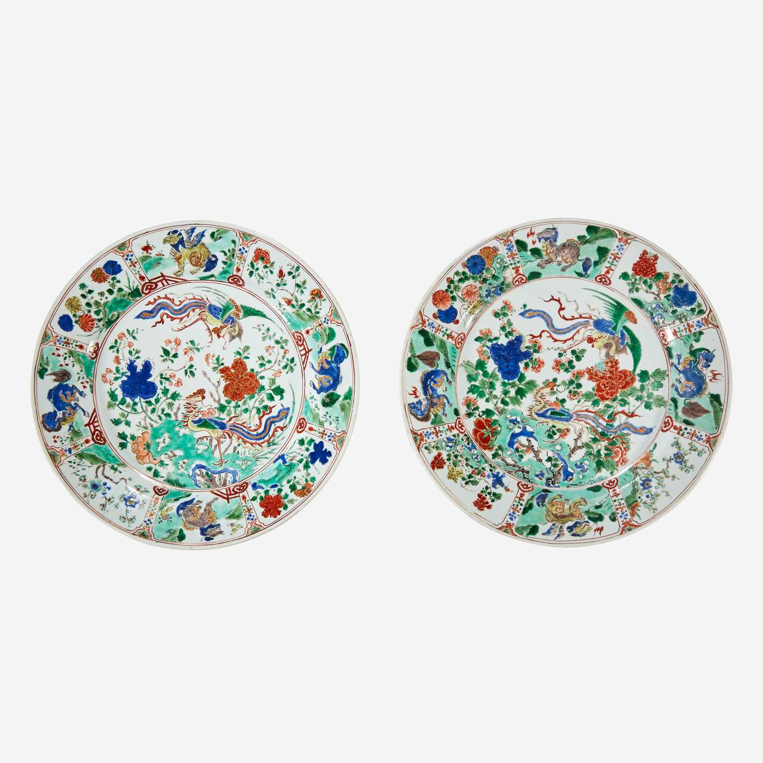 """Lot 57 - Two similar Chinese famille verte-decorated porcelain """"Phoenix and Peony"""" dishes"""