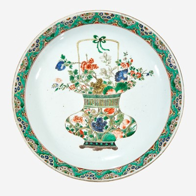 "Lot 51 - A Chinese famille verte-decorated porcelain ""Flower Basket"" charger"