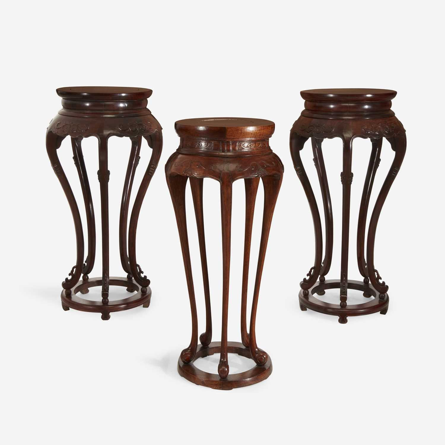 Lot 53 - A pair of Chinese hardwood circular stands, together with a similar Chinese carved hardwood circular stand