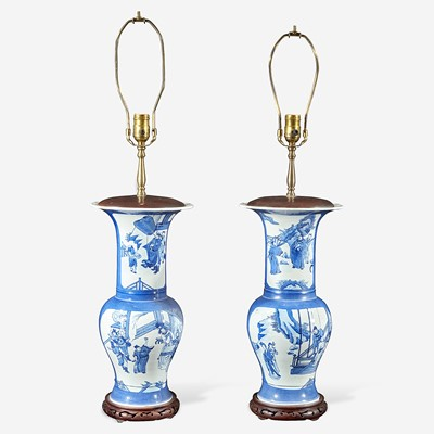 """Lot 60 - A pair of Chinese blue and white powder-blue ground """"Phoenix-tail"""" vases mounted as lamps"""