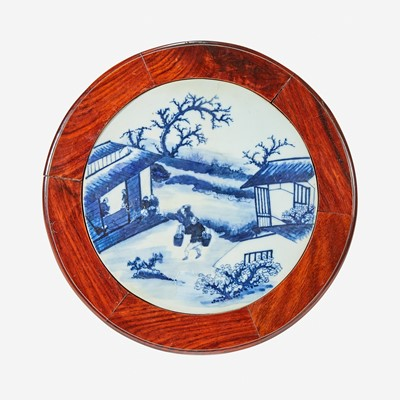 Lot 63 - A Chinese blue and white porcelain-inset hardwood revolving small stand