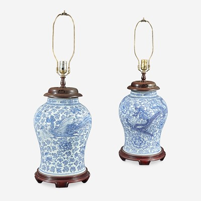 """Lot 73 - A pair of Chinese blue and white porcelain """"Peony and Dragon"""" jars, mounted as lamps"""