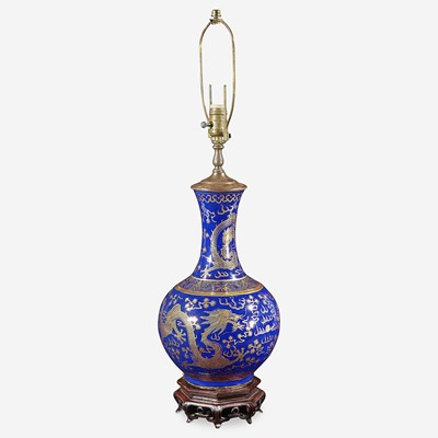 """Lot 74 - A Chinese gilt-decorated cobalt blue porcelain """"Dragon"""" bottle vase, mounted as a lamp"""