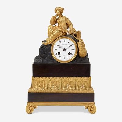 Lot 42 - A German Patinated and Gilt Bronze Mantel Clock