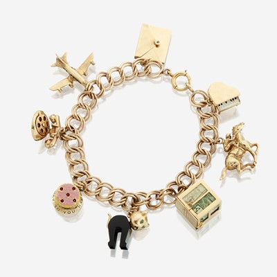 Lot 24 - A fourteen karat gold charm bracelet