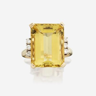 Lot 190 - A yellow beryl, diamond, and fourteen karat gold ring