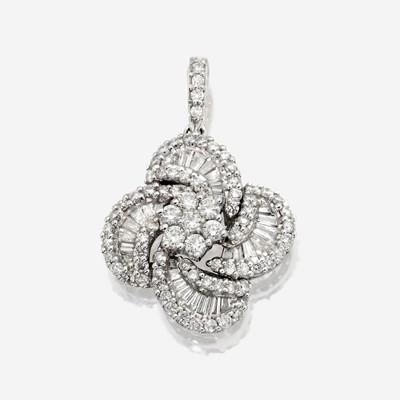 Lot 106 - A diamond and eighteen karat white gold pendant