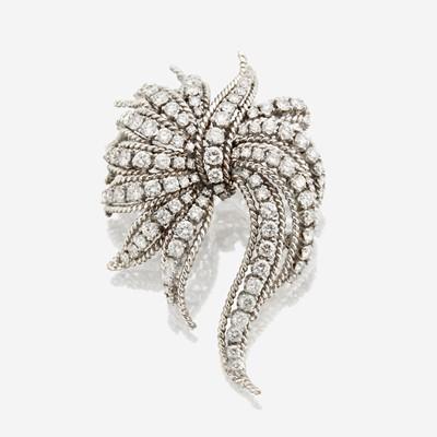 Lot 56 - A diamond and eighteen karat white gold brooch