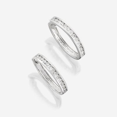 Lot 175 - A pair of diamond and fourteen karat white gold earrings
