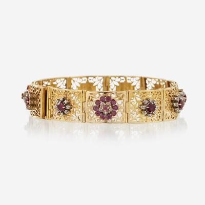 Lot 121 - A ruby, diamond, pink sapphire, and eighteen karat gold bracelet