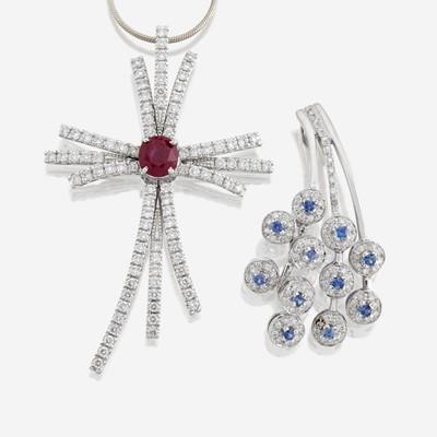 Lot 168 - Two eighteen karat white gold and gem-set pendants