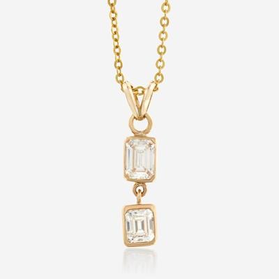 Lot 136 - A diamond and eighteen karat gold pendant