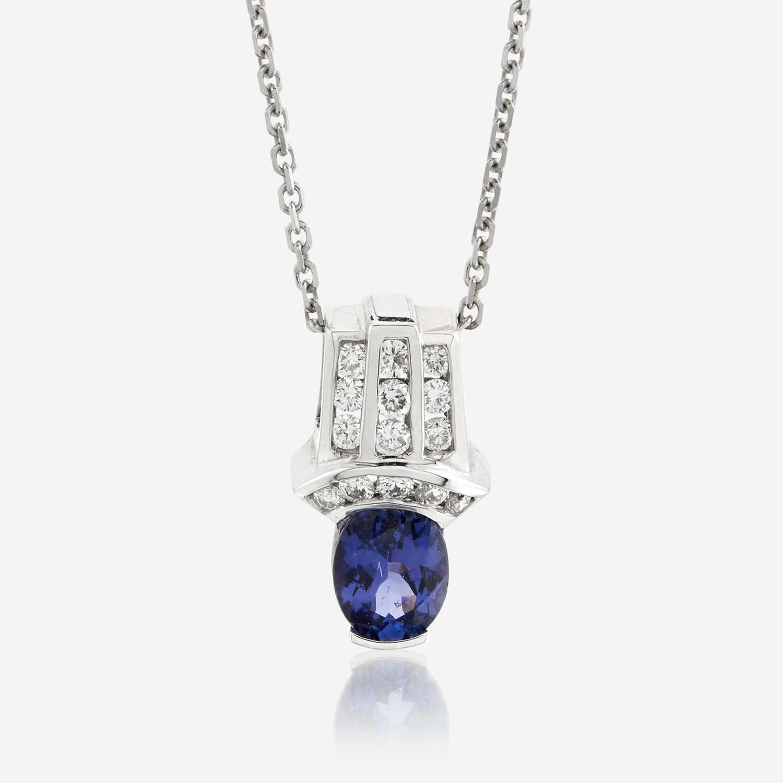 Lot 94 - A tanzanite, diamond, and fourteen karat white gold pendant