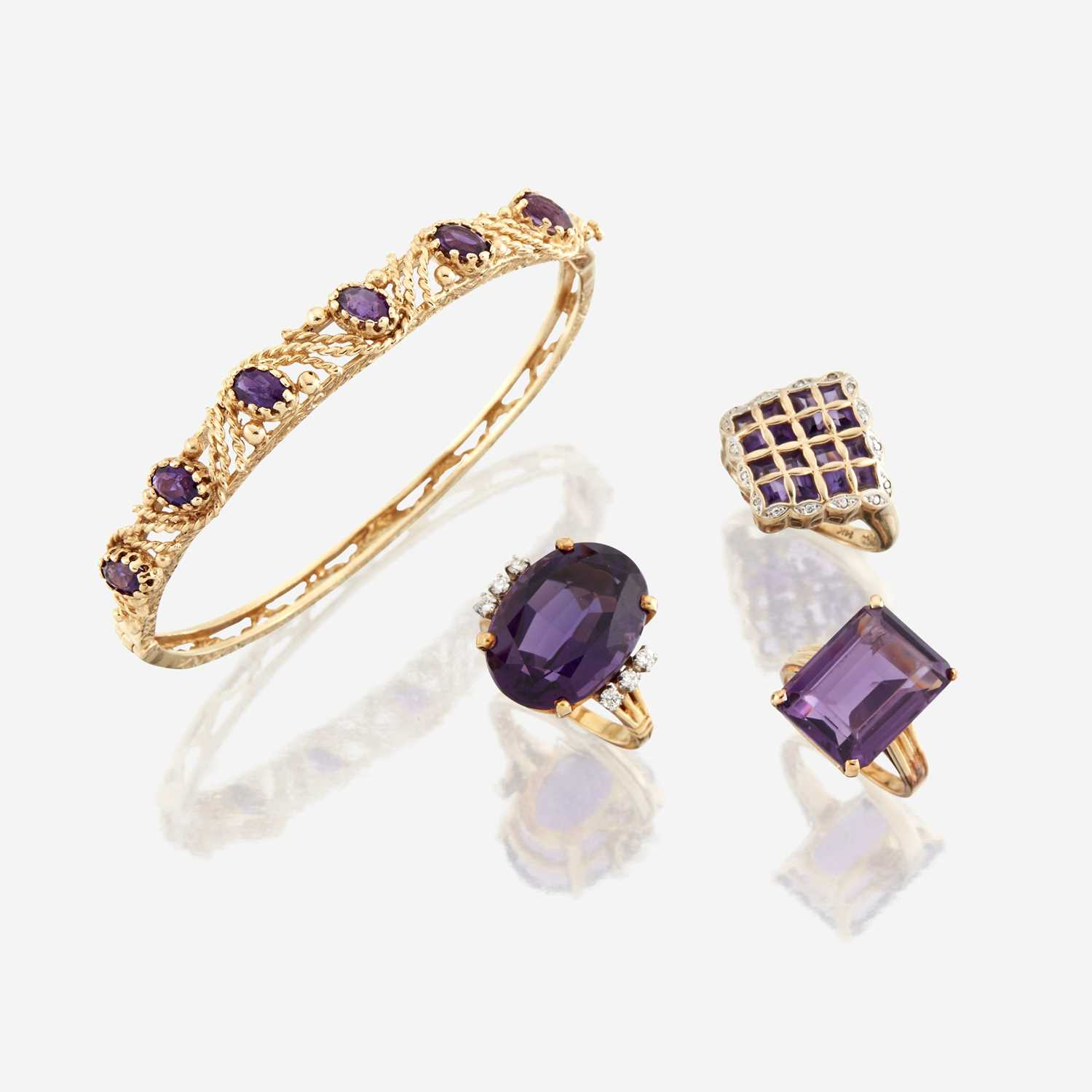 Lot 83 - A collection of four pieces of amethyst and gold jewelry