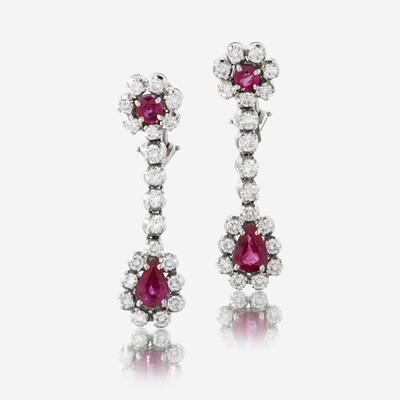 Lot 167 - A pair of diamond, ruby, and fourteen karat white gold earrings