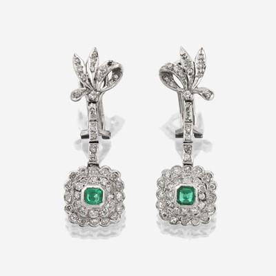 Lot 172 - A pair of diamond, emerald, and fourteen karat white gold earrings