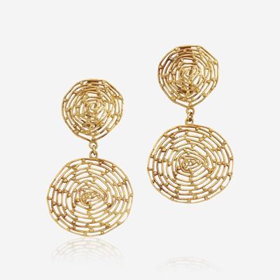 Lot 186 - A pair of eighteen karat gold ear clips