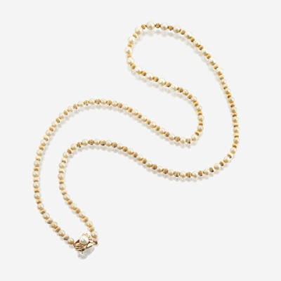 Lot 30 - A cultured pearl, bead, and fourteen karat gold necklace