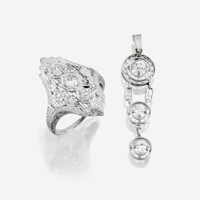 Lot 109 - An eighteen karat white gold and diamond ring with similar pendant