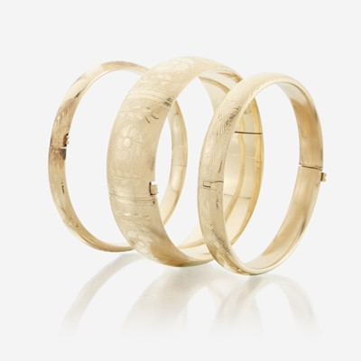 Lot 43 - A collection of three fourteen karat gold bangles