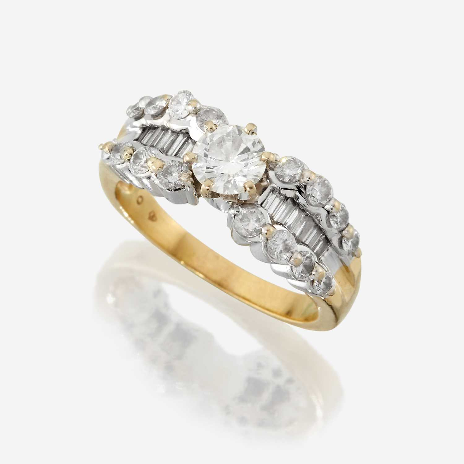 Lot 35 - A diamond and eighteen karat two tone gold ring