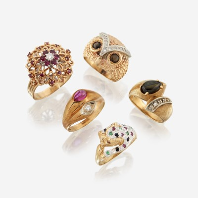 Lot 124 - A collection of five fourteen karat gold and gem-set rings