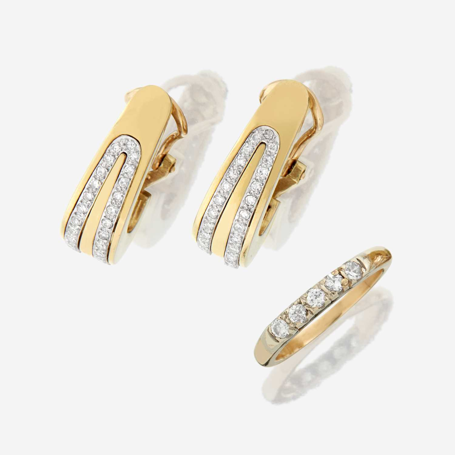 Lot 46 - A pair of fourteen karat gold and diamond earrings with similar ring