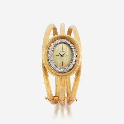 Lot 119 - A diamond and eighteen karat gold bangle watch