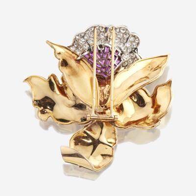 Lot 58 - A Retro diamond, ruby, and eighteen karat gold clip brooch
