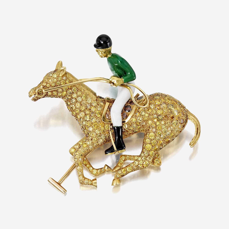 Lot 74 - A colored diamond, enamel, and eighteen karat gold brooch