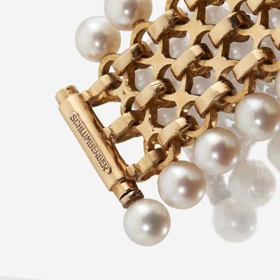 Lot 56 - An eighteen karat gold, cultured pearl, and diamond bracelet, Schlumberger