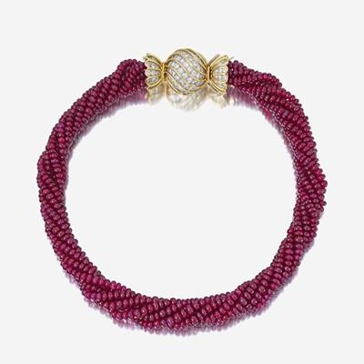 Lot 135 - A ruby bead, diamond, and eighteen karat gold necklace, Bulgari