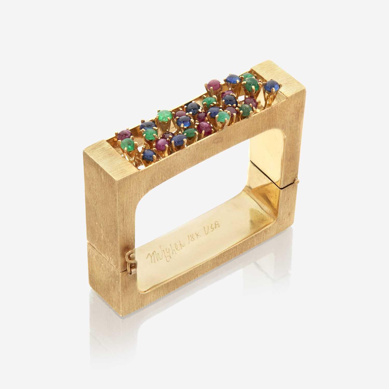 Lot 42 - An eighteen karat gold and gem-set bangle, Mugler