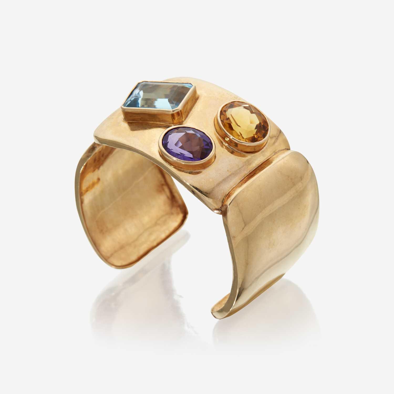 Lot 82 - A fourteen karat gold and gem-set cuff