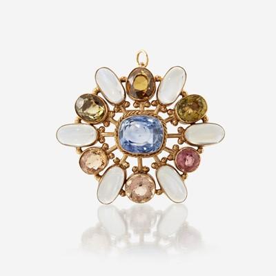 Lot 162 - A fourteen karat gold and gem-set pendant/brooch