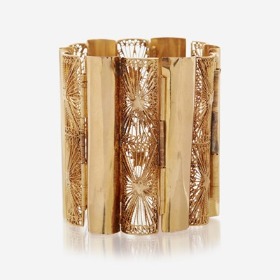 Lot 187 - A fourteen karat gold wide bracelet