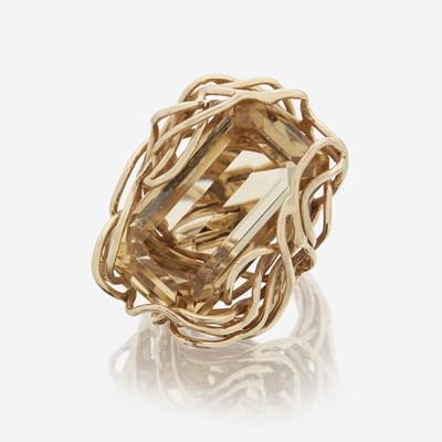 Lot 84 - A citrine and fourteen karat gold ring