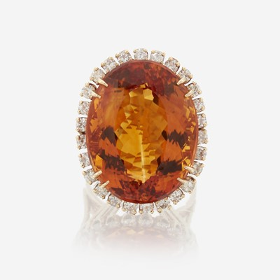 Lot 85 - A citrine, diamond, and fourteen karat gold ring