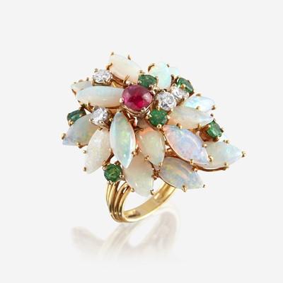 Lot 154 - An eighteen karat gold, opal, diamond, emerald, and ruby cluster ring