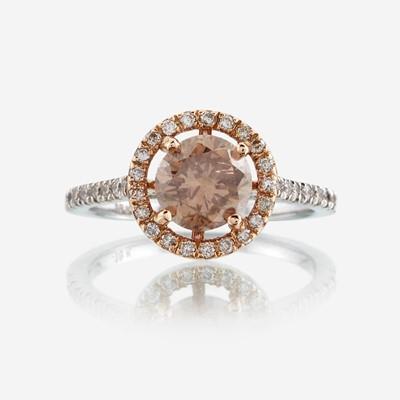 Lot 104 - A colored diamond, diamond, and eighteen karat two tone gold ring