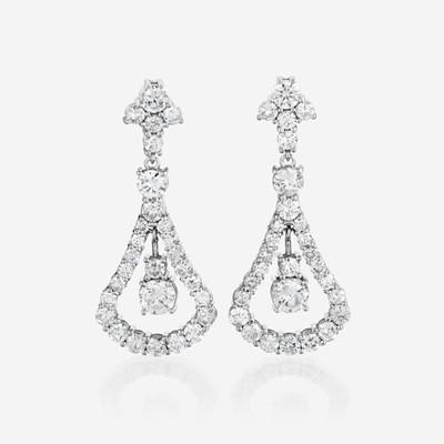 Lot 74 - A pair of diamond and eighteen karat white gold earrings