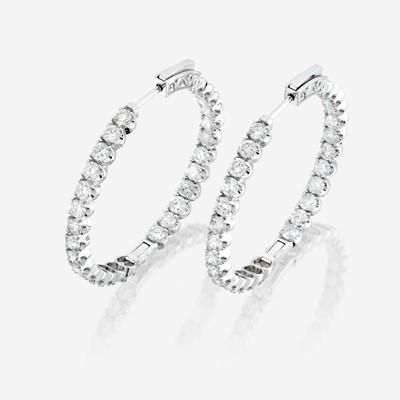 Lot 57 - A pair of diamond and eighteen karat gold earrings