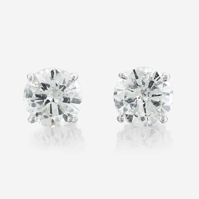 Lot 169 - A pair of diamond and eighteen karat white gold earrings