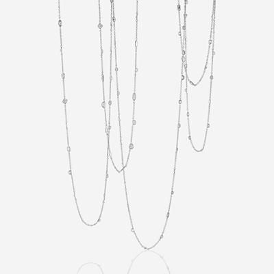 Lot 68 - A diamond and eighteen karat white gold long chain